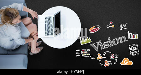 Woman on her laptop against black background - Stock Photo