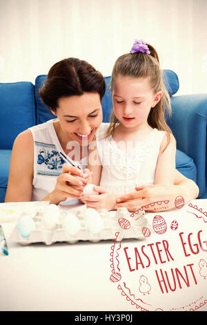 Mother and daughter painting easter eggs against easter egg hunt logo against white background - Stock Photo