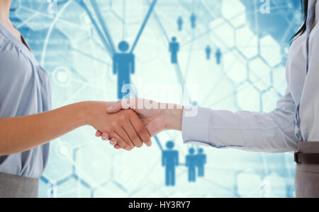 Businesswomen shaking hands against people icons and binary codes - Stock Photo