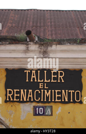 Taller El Renacimiento sign on a house in Guatemala Antigua - Stock Photo