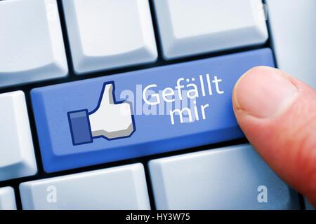 If likes I-key and Facebook thumb on a computer keyboard, symbolic photo Facebook, Gefällt mir-Taste und Facebook - Stock Photo