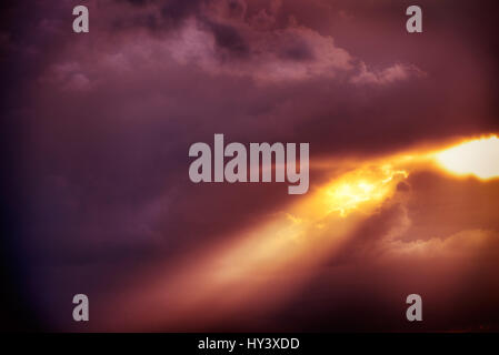 Cloud formation, sunrays break through the cloud cover, Wolkenformation, Sonnenstrahlen durchbrechen die Wolkendecke - Stock Photo