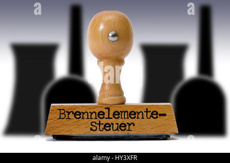 Stamp with the label Fuel element-expensive, Stempel mit der Aufschrift Brennelementesteuer - Stock Photo