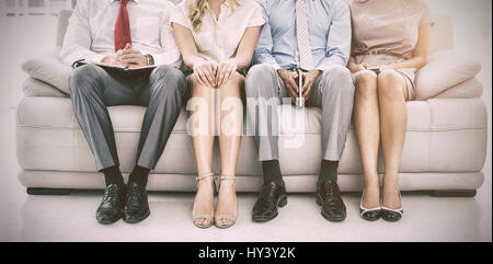 Portrait of executives waiting for job interview in office - Stock Photo