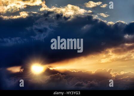 Cloud formation, sunrays break through the cloud cover, Wolkenformation, Sonnenstrahlen durchbrechen die Wolkendecke - Stock Photo