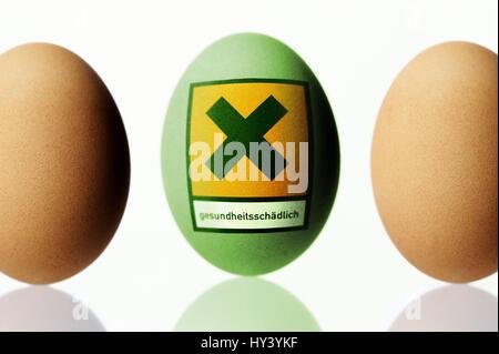 Huehnerei with danger sign, dioxin load with chicken eggs, Huehnerei mit Gefaehrdungszeichen, Dioxinbelastung bei - Stock Photo