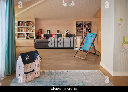 Interior design in the children's room. shelves with toys. Domestic comfortable life. - Stock Photo