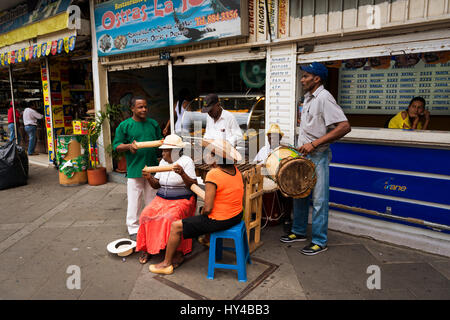 Cali, Colimbia - February 6, 2014: Street musicians playing in a street in the city of Cali, in Colombia - Stock Photo
