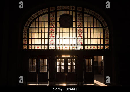 Haydarpasa train station's main entrance into the light, the sun being filtered by art deco stained-glass  Picture - Stock Photo