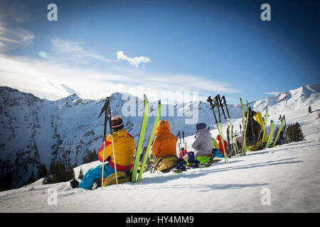 Relaxing in sunlight with Alpine panorama - Stock Photo