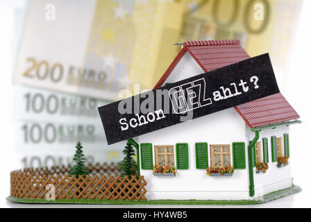 Miniature house with GEZ slogan Already Paid fees GEZ per household, Miniaturhaus mit GEZ-Slogan Schon GEZahlt GEZ - Stock Photo