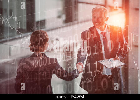 Stocks and shares against businessman shaking hands with colleague - Stock Photo