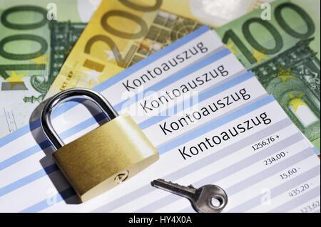 Bank statements and padlock, security of bank data, Kontoauszuege und Vorhaengeschloss, Sicherheit von Bankdaten - Stock Photo