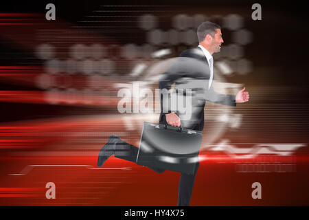Running businessman against red light beams with skyscrapers - Stock Photo