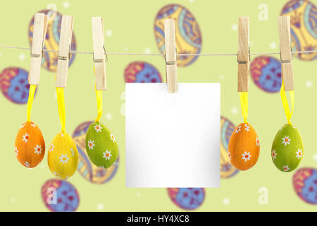 hanging easter eggs against composite image of multi colored easter eggs - Stock Photo