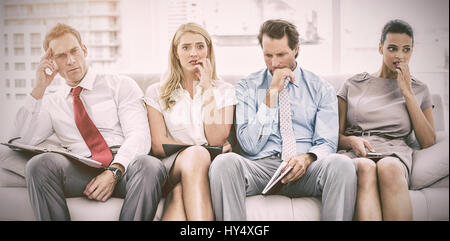 Nervous business people waiting for job interview - Stock Photo