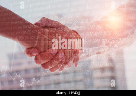 Stocks and shares against close up of business partners shaking hands - Stock Photo