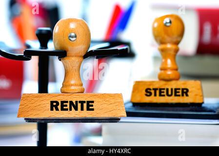 Stamp with the label Pension and Tax, Stempel mit der Aufschrift Rente und Steuer