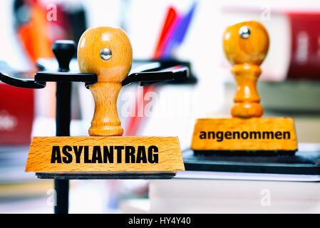 Stamp with the label Asylum application and accepted, Stempel mit der Aufschrift Asylantrag und angenommen - Stock Photo