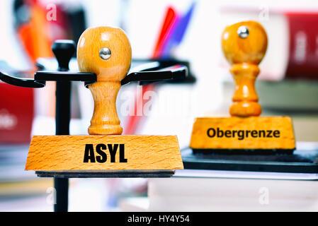 Stamp with the label Asylum and Upper limit, Stempel mit der Aufschrift Asyl und Obergrenze - Stock Photo