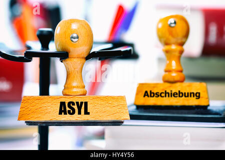 Stamp with the label Asylum and Deportation, Stempel mit der Aufschrift Asyl und Abschiebung - Stock Photo