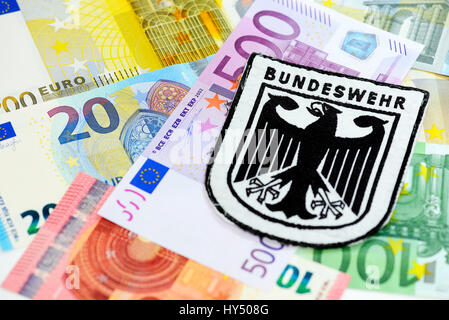 Armed forces badges on bank notes, rise of the military expenses, Bundeswehr-Abzeichen auf Geldscheinen, Erhoehung - Stock Photo