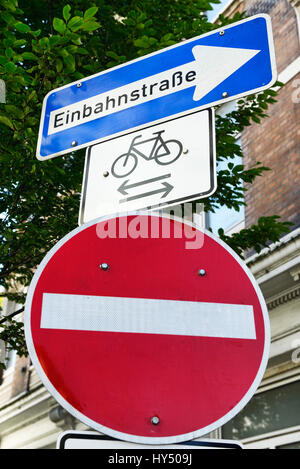 One-way street may be driven on by bicycles in both directions, road signs in Hamburg, Einbahnstra?e darf von Fahrraedern - Stock Photo
