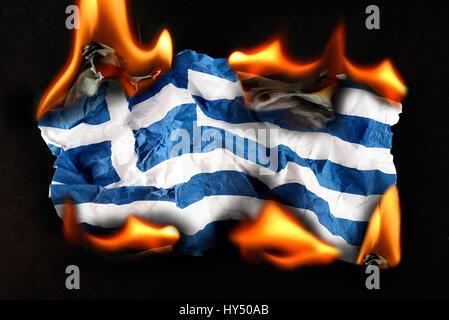 Greece flag in flames, symbolic photo debt quarrel, Griechenlandfahne in Flammen, Symbolfoto Schuldenstreit - Stock Photo