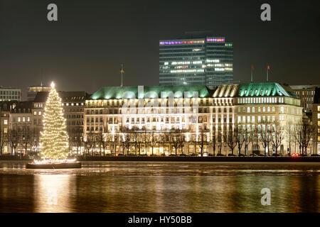 Christmas fir on the Inner Alster and hotel Four seasons in Hamburg, Germany, Europe, Weihnachtstanne auf der Binnenalster - Stock Photo