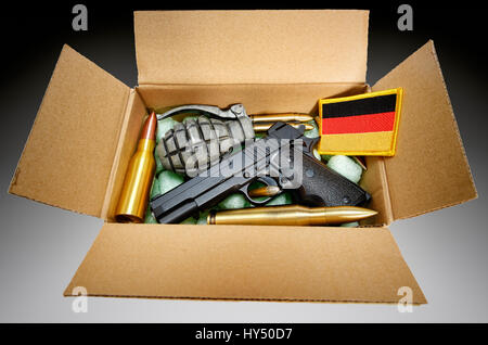 Package with weapons and Germany flag, symbolic photo German deliveries of arms, Paket mit Waffen und Deutschlandfahne, - Stock Photo