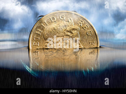 British one-pound coin in the water, low pound course, Britische Ein-Pfund-Muenze im Wasser, niedriger Pfund-Kurs - Stock Photo