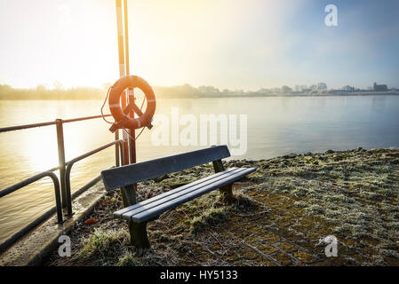 Bench with hoarfrost covered in the Faehranleger on the Elbe in Kirchwerder, 4 and marshy land, Hamburg, Germany, - Stock Photo
