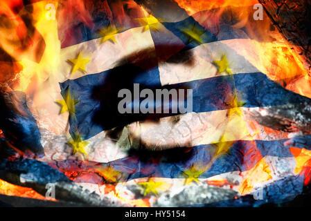 Greek flag, flames and eurosigns, symbolic photo debt quarrel, Griechische Fahne, Flammen und Eurozeichen, Symbolfoto - Stock Photo