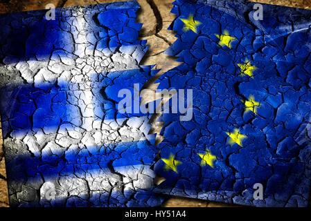 Greece and EU flag with tears, symbolic photo Grexit, Griechenland- und EU-Fahne mit Rissen, Symbolfoto Grexit - Stock Photo