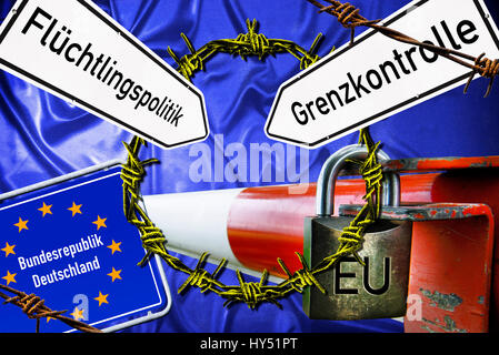 Tollgate and EU flag with barbed wire, symbolic photo refugee's crisis, Schlagbaum und EU-Fahne mit Stacheldraht, - Stock Photo