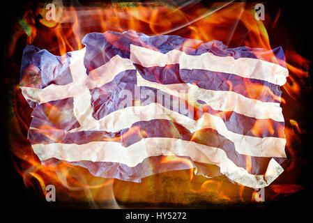 Crumpled Greek flag in flames, symbolic photo debt quarrel, Zerknitterte Griechische Fahne in Flammen, Symbolfoto - Stock Photo