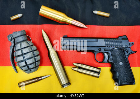 Weapons and ammunition on Germany flag, symbolic photo German deliveries of arms, Waffen und Munition auf Deutschlandfahne, - Stock Photo
