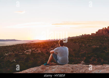 USA, Utah, Moab, Man looking at view in Arches National Park - Stock Photo