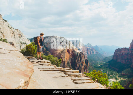 USA, Utah, Man looking at view in Zion National Park - Stock Photo