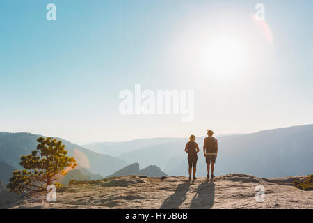 USA, California, Yosemite National Park, Woman and man at Taft Point - Stock Photo