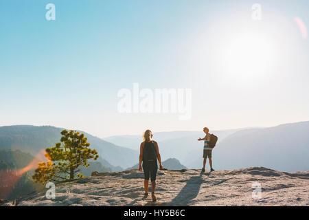 USA, California, Yosemite National Park, Man and woman at Taft Point - Stock Photo