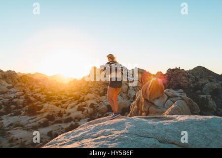 USA, California, Woman at rocks in Joshua Tree National Park, - Stock Photo