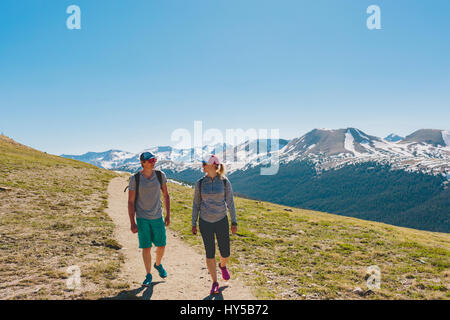 USA, Colorado, Rocky Mountain National Park, Two people hiking in mountains - Stock Photo
