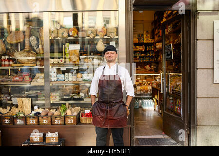 Sweden, Man in apron standing in front of store - Stock Photo
