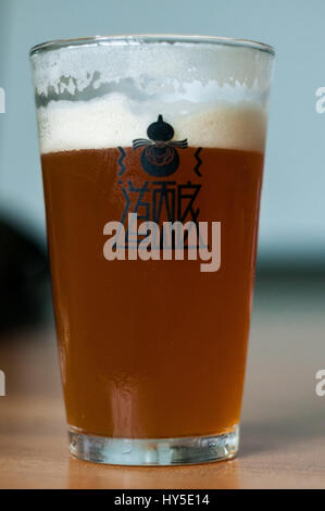 A cool glass of Chengdu's Harvest Brewery's IPA. - Stock Photo