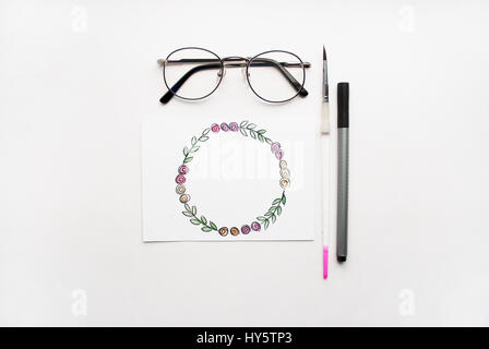 Composition on a white background. Hand drawn floral wreath frame. Flat lay - Stock Photo