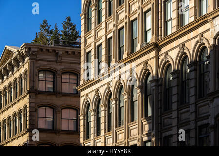 Typical Soho building facades with ornamentation and terraces, Manhattan, New York City - Stock Photo