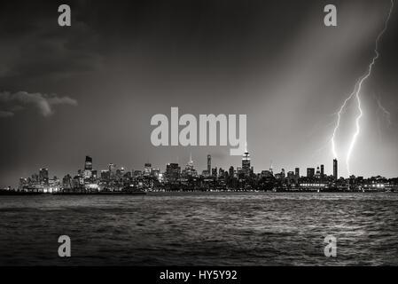 Lightning striking  New York City skyscraper at twilight (Black & White) - Stock Photo