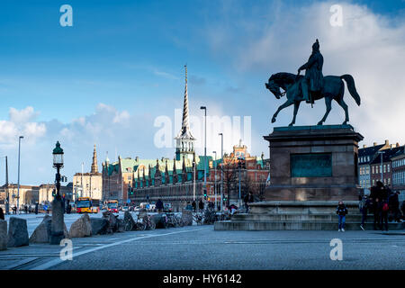 Striking equestrian statue of Christian IX with Børsen, a 17th century stock exchange in the background, Copenhagen, - Stock Photo