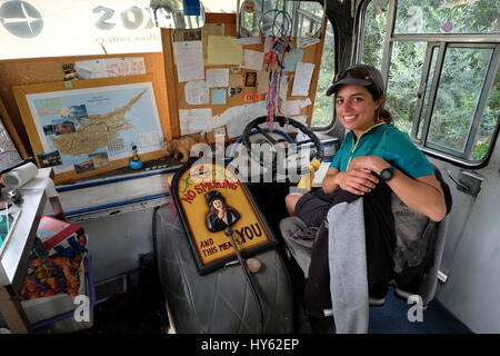 Backpacker Justine is staying in an old bus in Paphos,Cyprus. The bus was provided as free accommodation by a young - Stock Photo